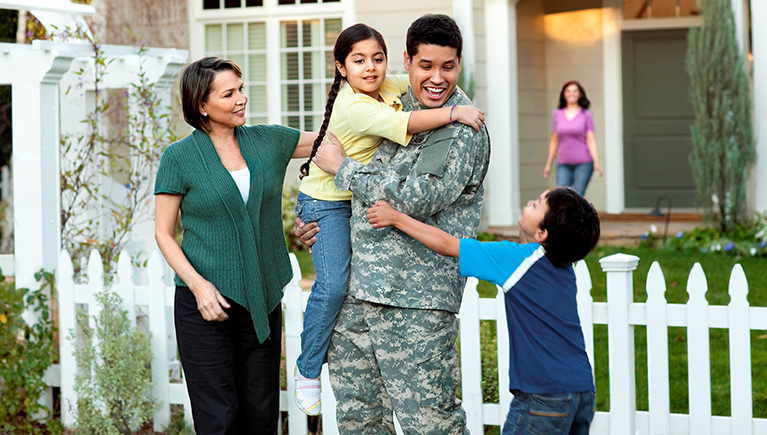 Photo of soldier with family