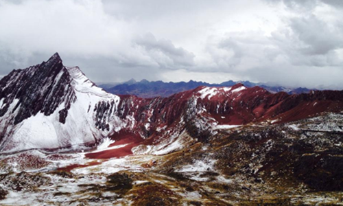 Image of snowy and red mountain landscape
