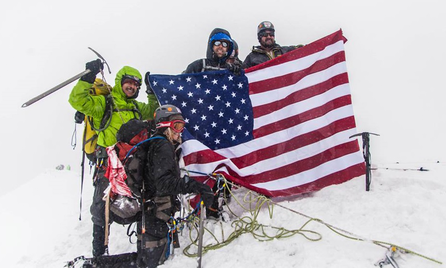 S2S team at the top of the summit. Pedro and teammates proudly hold the American Flag he discusses in his blog.