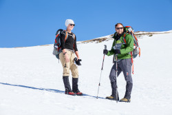 Guide Margaux, on the left, stops with team member Jody. Photo taken during the team's May training in Colorado. Photo credit: Mike Herbener