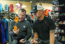 Team member Stuart works with expedition leader Jeff Evans to get his crampons fit at Bent Gate Mountaineering. Photo credit: Rob Jackson