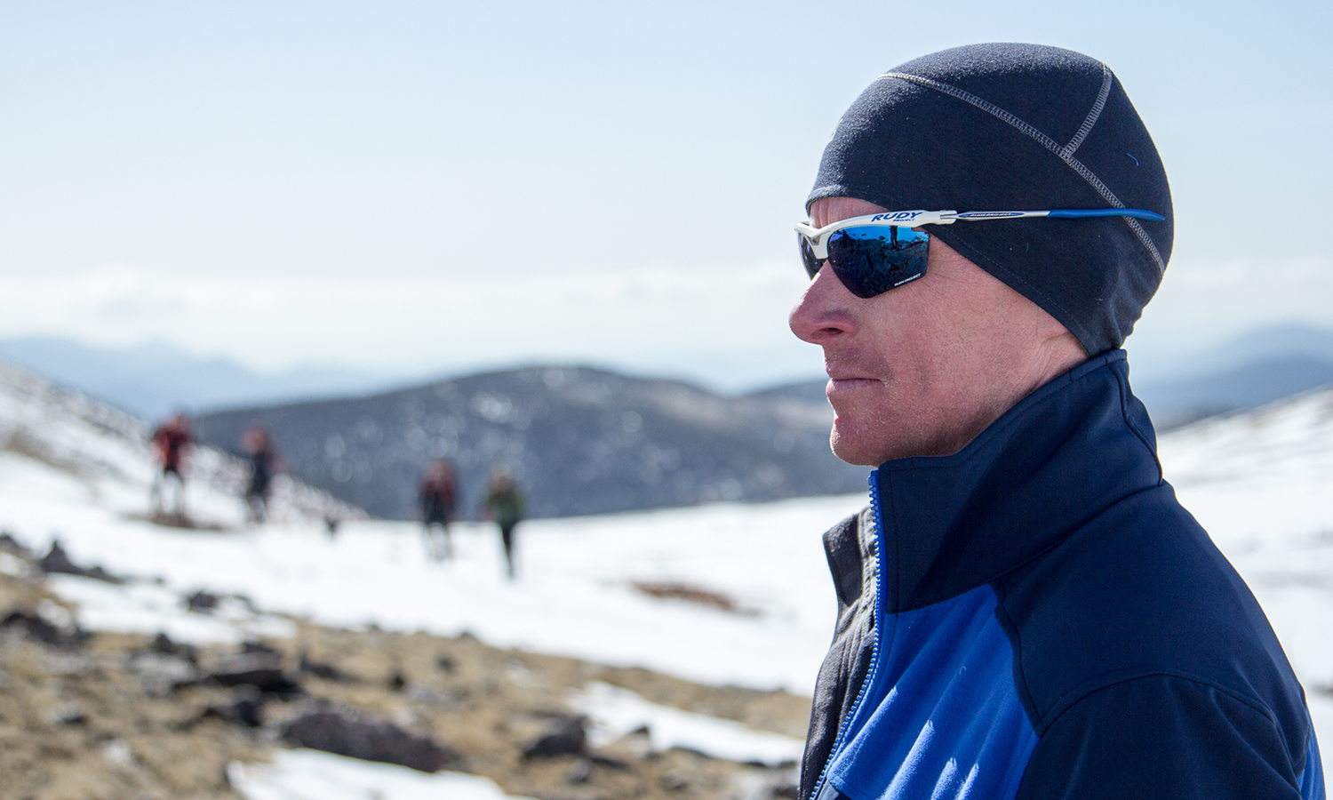 Profile image of craig, current soldier, in sunglasses, blue hat and blue jacket looking out ahead.