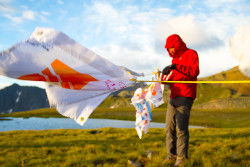 Expedition Leader Charley Mace setting up the flags at basecamp