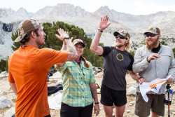 Leader Josh high fives team mates Stevi, Brian and David